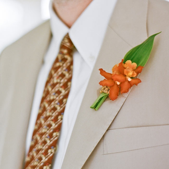 Peter's burnt orange orchid boutonniere combined classic with exotic for a cool look against his neutral suit.