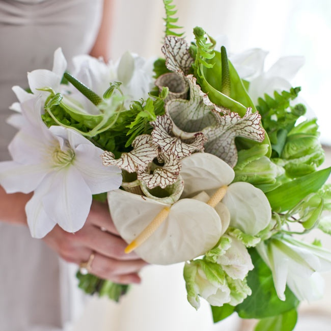 Tess's bridesmaids carried bouquets of neutral lilies with textured leafy greens.