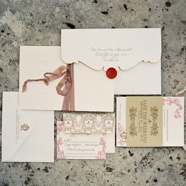 """The design concept of the invitations remained true to the elegant feel of our wedding.The traditional ecru color with thick paper stock and letterpress text and scroll work spoke to us,"" Jessica says."