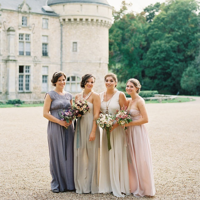 "Each bridesmaid had their own specific dress and style. ""I wanted  the bridesmaids to reflect our undefined color story in its effortless mix, so I chose a soft palette of ivory, nude, blush pink and lavender gowns, bringing in pops of dark romantic color in the headpieces and jewelry,"" Jessica says."