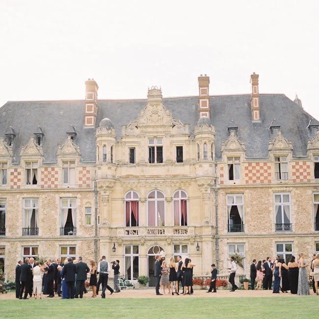 The cocktail hour was held on an adjacent side of the castle than the ceremony. Guests could meander in and out of the chateau and into designated garden areas.