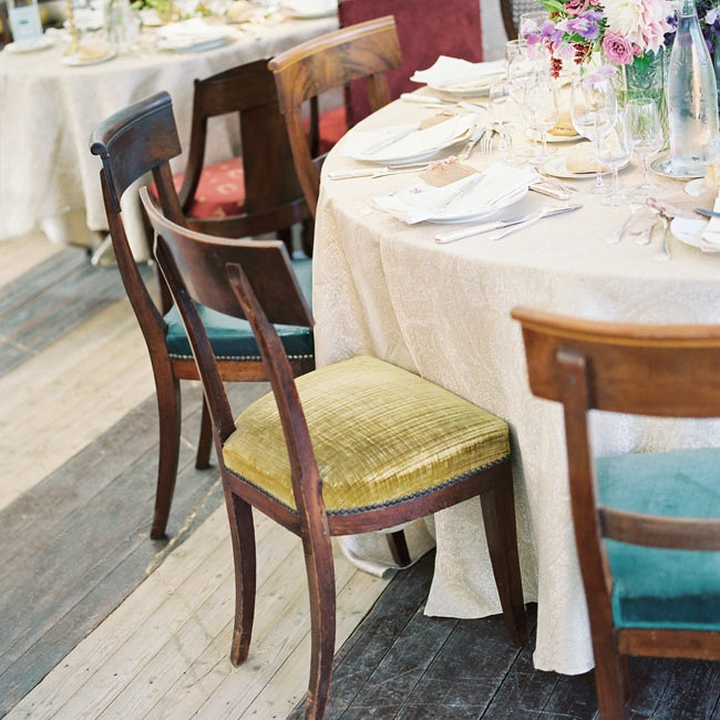 Chairs at the reception were upholstered with different colors of velvet fabrics to give the design an eclectic feel.