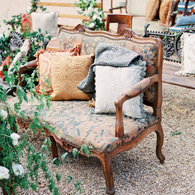 Antique furniture lounges with luxe patterned pillows lined the reception area.