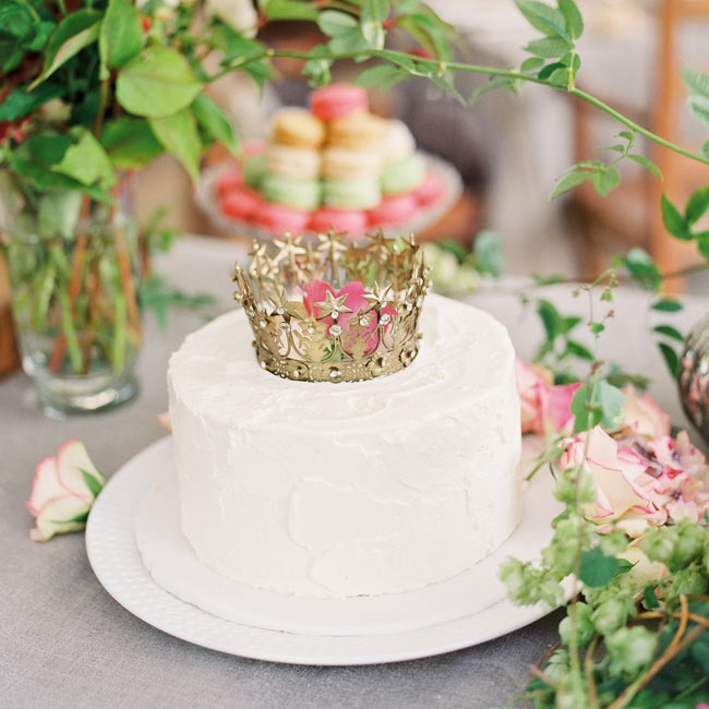 Each cake was topped with an ornate golden crown befitting the elegant venue space.