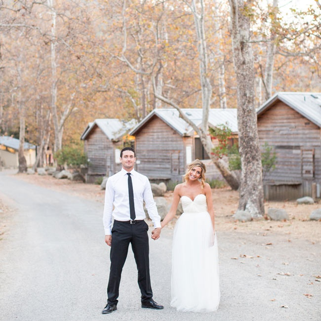 The bride and groom stopped to snap this picture with the site's cabins in the background.