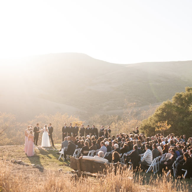 The ceremony took place inside a canyon with a beautiful sunlit, hillside view.