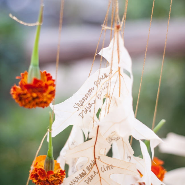 The escort cards were actually white leaves with the names of guests and tables written on them.