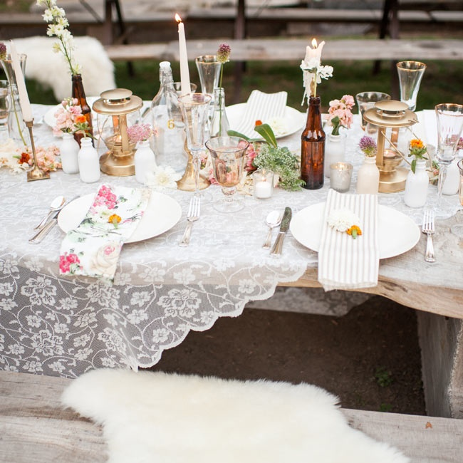 Lace, china and floral linens lined the reception tables at the couple's dinner.