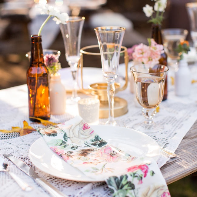 Gold-rimmed glassware along with brown bottles, rustic wood and lace gave the entire atmosphere a woodsy feel.