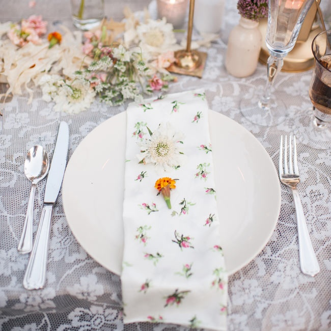 Each table napkin was a different floral linen pattern topped with an orange flower bloom.