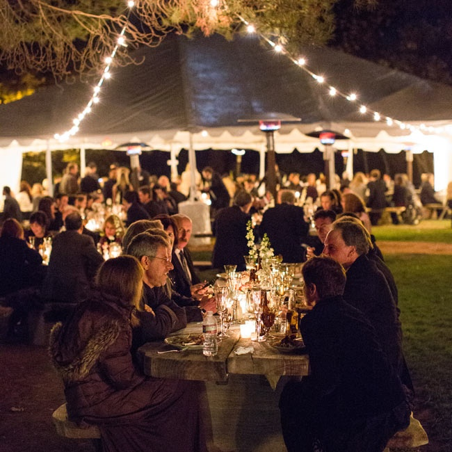 As the sun set, the couple turned on their bistro lighting and illuminated their tented reception space.