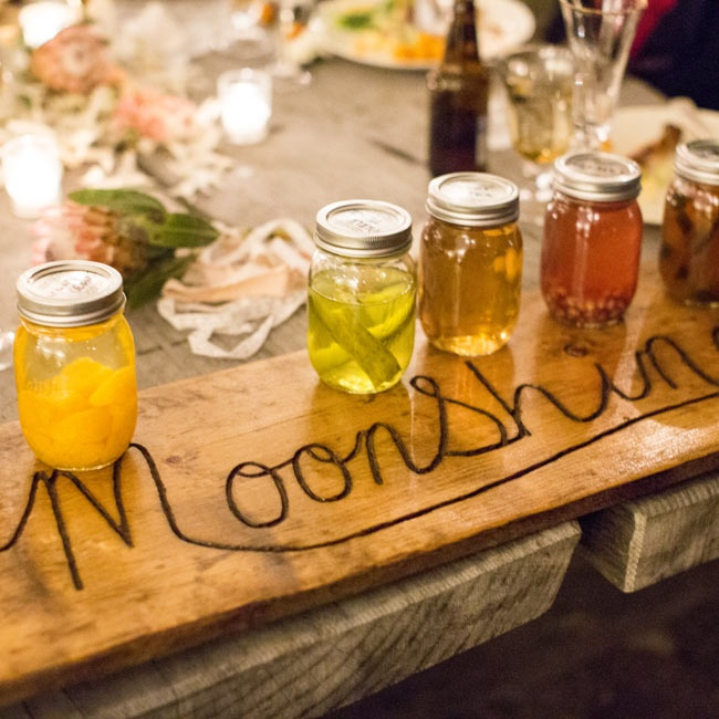 Guests could choose from different moonshines indicated by a rustic wooden sign.