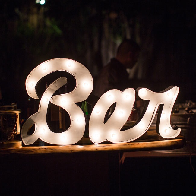 Just like the couple's LOVE sign, they had a similar sign that signaled guests towards the bar.