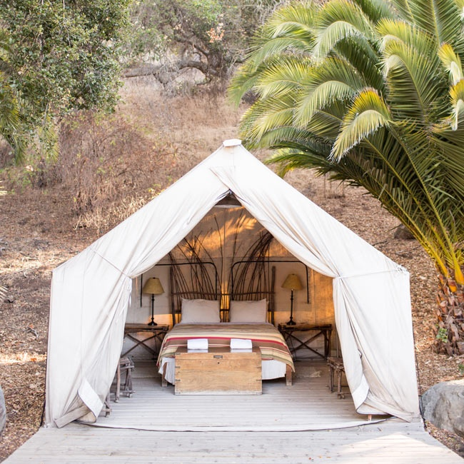 The bride and groom spent the night in this glam tent, perfect for an outdoorsy couple.