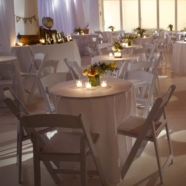 At the reception, as with the ceremony, the wedding planner used many white details with pops of yellow that really stood out with an intimate candlelit feel.