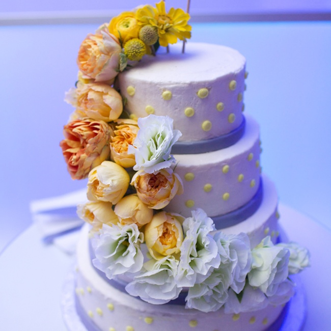 A modern cake with polka dots and cascading flowers was a fitting celebration for the bride and groom.