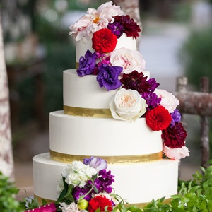 Vibrant Flower-Topped Wedding Cake