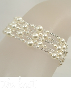 Sterling silver or 14K gold bracelet features Swarovski crystals and pearls. Various crystal and pearl colors; Adjustable length.