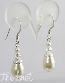 "Sterling silver or 14K gold earrings feature Swarovski crystals and pearls. Various crystal and pearl colors; 1"" length."