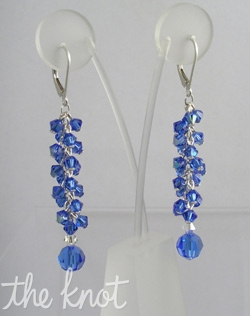 "Sterling silver or 14K gold earrings feature Swarovski crystals. Various colors available; 2"" length."