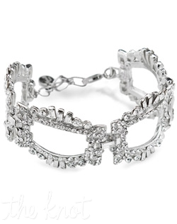 Silver bracelet features clear crystals.