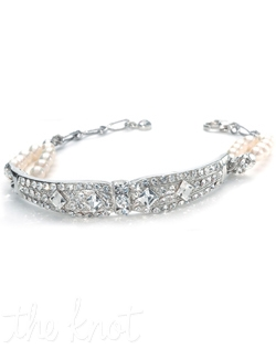 Bracelet features freshwater pearls and Austrian crystals.