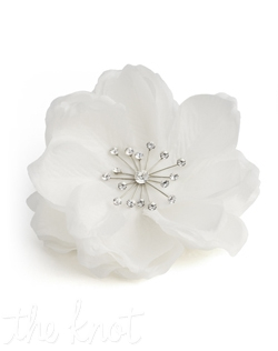 Silk clip features rhinestone spray center. White or ivory.