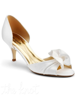 Kitten-toe peep-toe with rouching detail. Sizes 5.5-10