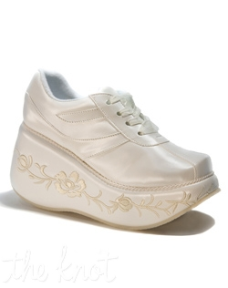 "Ivory bridal sneaker wedge features embroidered 3"" platform. Sizes 5-10"