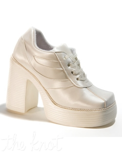 Ivory bridal sneaker features 4&quot; platform heel. Sizes 5-11