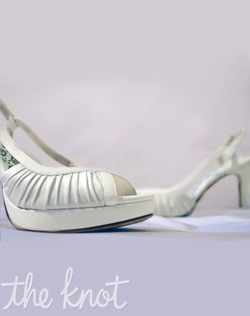 "White ruched silk satin peep-toe platform slingback features 3 or 4"" heel, pearlescent ivory straps, and full Poron® padded insole with built-in arch support. Sizes 5-10"