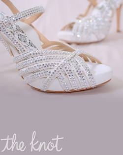 "White microfiber suede peep-toe platform sandal features 4"" heel, rhinestones, and full Poron® padded insole with built-in arch support. Sizes 5-10"