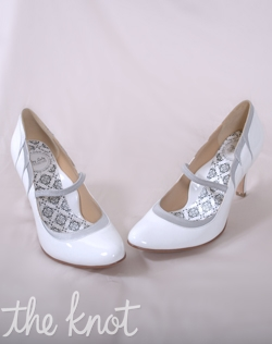 "White and silver patent leather platform Mary Jane pump features 3 or 4"" silk satin scalloped heel and full Poron® padded insole with built-in arch support. Sizes 5-10"