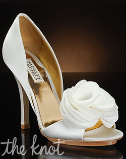 Open-toe D' Orsay pump with layered fabric that creates a flower decoration on the toe.
