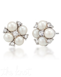 "Silvertone earrings feature white-simulated pearls and crystals. 1/2"" L"