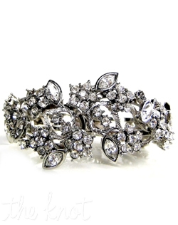 Rhodium bracelet features hinge cuff, Swarovski crystals, and hand-crafter floral design.