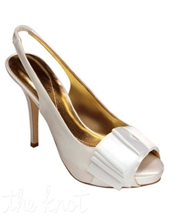 "White shoe features 4.25"" heel. Sizes 6-9.5"