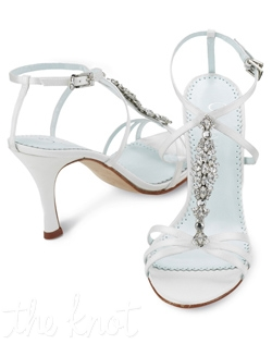 "Shoe features 3.25"" heel. White or ivory. Sizes 5-11M"