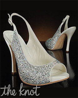 Rhinestone studded slingback wedding shoe features peep-toe and covered platform.