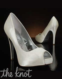 Peep-toe pump features covered platform.