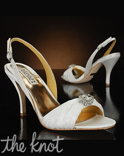 Slingback shoe features ruched fabric at toe adorned with silver rhinestone brooch.