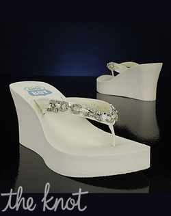 "Ivory flip flop features silver embellishments and 3-1/2"" heel."