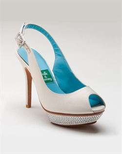 White silk platform sandal features Swarovski crystals. Also customizable in various colors, fabrics, and heel heights.