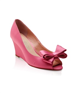 Pink silk wedge features bow detail. Also customizable in various colors, fabrics, and heel heights.