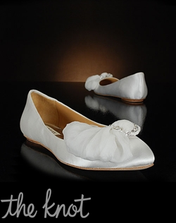 White flat features tulle and crystal decoration at toe.
