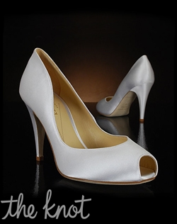White silk pump features peep-toe.