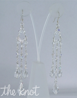 "Sterling silver or 14k gold-filled earrings feature Swarovski crystals. 3"" L"