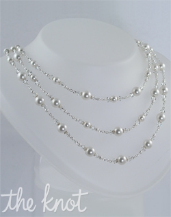 Sterling silver or 14k gold-filled necklace features Swarovski crystals and pearls that are available in various colors. Adjustable length