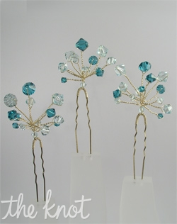 Silver or gold hairpins feature Swarovski crystals that are available in various colors.