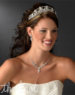 Sterling silver plated tiara features rhinestones and Swarovski crystals. Various color accents available.<p> Matching rhinestone jewelry set available.